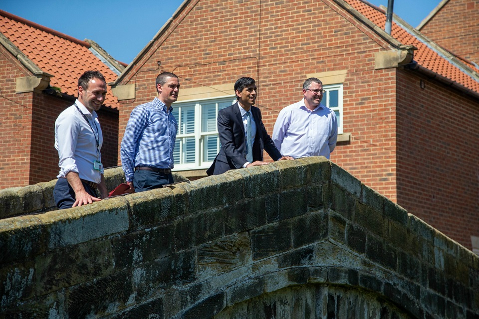 Image shows Rishi Sunak MP with Environment Agency staff